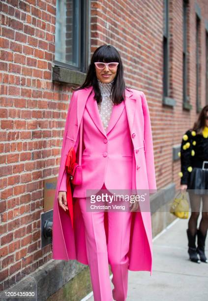 Babba Rivera is seen wearing pink suit and coat outside Zimmermann during New York Fashion Week Fall / Winter on February 10, 2020 in New York City.