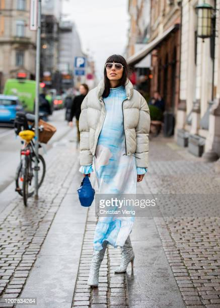 Babba Rivera seen wearing blue white dress, cropped down feather jacket, blue bag outside Helmstedt during Copenhagen Fashion Week Autumn/Winter 2020...