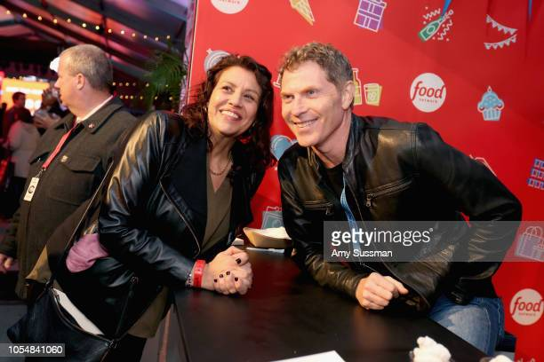 Babby Flay poses for a photo with a guest during Food Network's 25th Birthday Party Celebration at the 11th annual New York City Wine Food Festival...