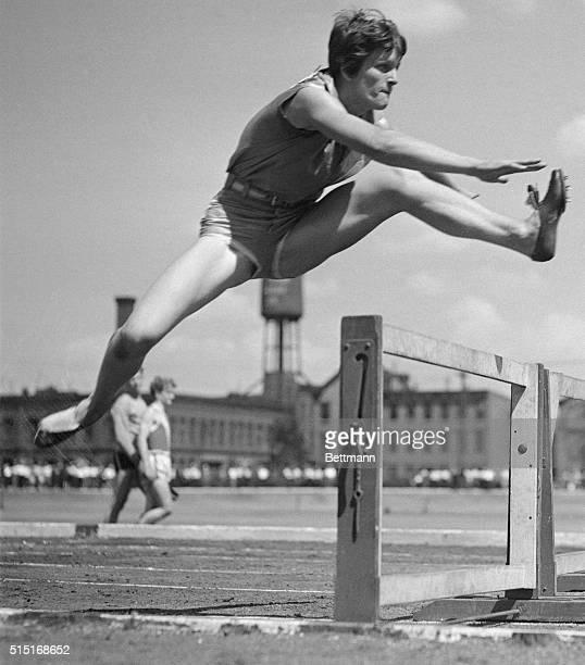 Babe Didrickson Jumping over Hurdle