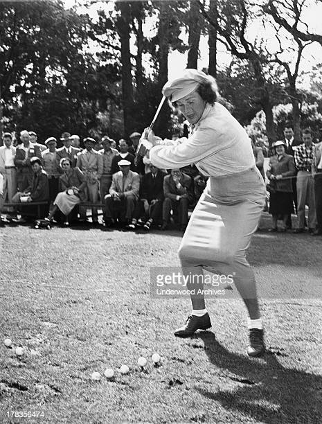 Babe Didrikson gives a golf demonstration on teeing off in a tight skirt at the Weathervane golf tournament Pebble Beach California c 1951