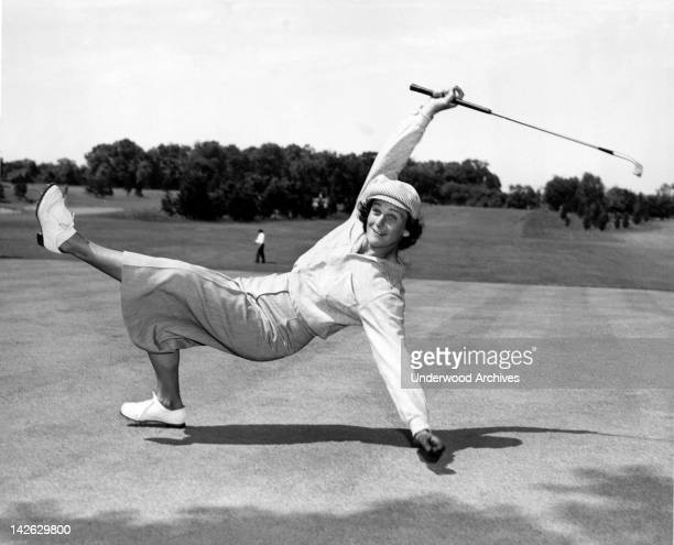 Babe Didrikson Zaharias uses a bit of body english to sink a putt at the AllAmerican tournament at Chicago's TamO'Shanter Country Club Chicago...