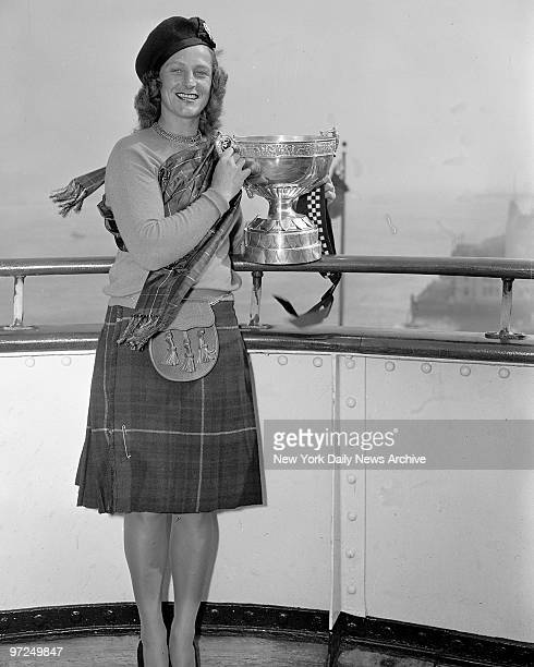 Babe Didrikson Zaharias with the Birtish Women's Amateur Championship Cup which left England for the first time