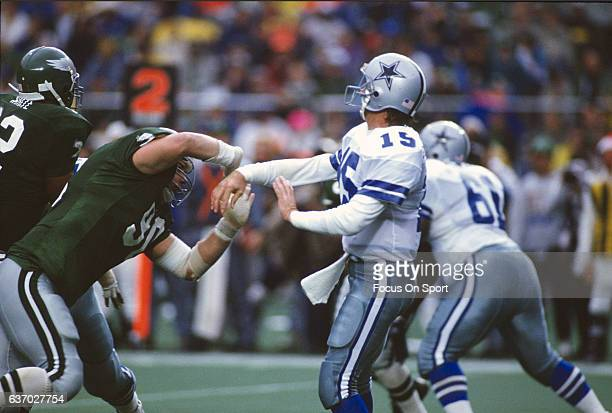 Babe Laufenberg of the Dallas Cowboys gets his pass off under pressure from Mike Golic of the Philadelphia Eagles during an NFL football game circa...