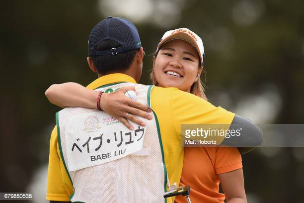 Babe Liu of Taiwan hugs her caddie on the 18th green during the final round of the World Ladies Championship Salonpas Cup at the Ibaraki Golf Club on...