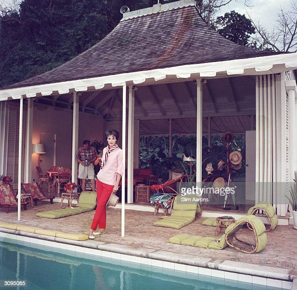 Babe Paley by the pool Her husband William Paley is snapping the photographer at their cottage Round Hill Jamaica A Wonderful Time Slim Aarons