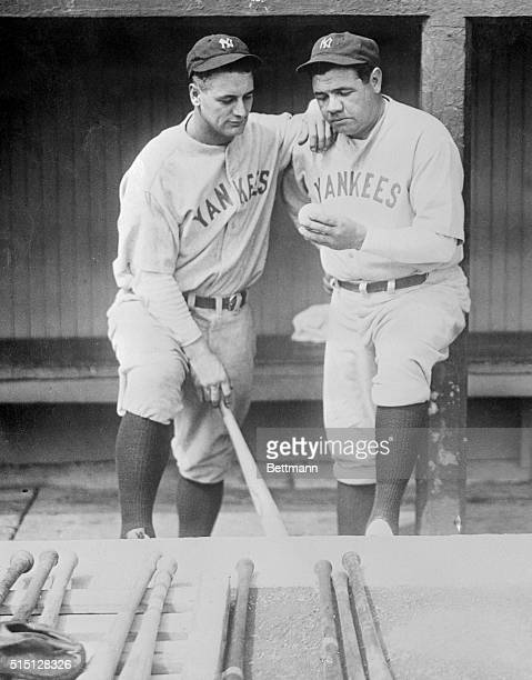 Babe Ruth and Lou Gehrig look at the ball which flew over the left field wall of Dunn field in Cleveland Ohio for the Babe's 500th home run of his...