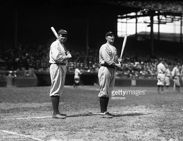 Babe Ruth and Ty Cobb, two of the American League's heaviest hitters, stand together during pregame exercises at the Polo Grounds.