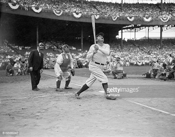 Babe Ruth belts a high one during war bond game at Polo Grounds
