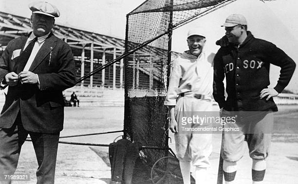 Babe Ruth Boston Red Sox pitcher and outfielder laughs with manager Ed Barrow left and Billy Sunday center during a spring training workout in...