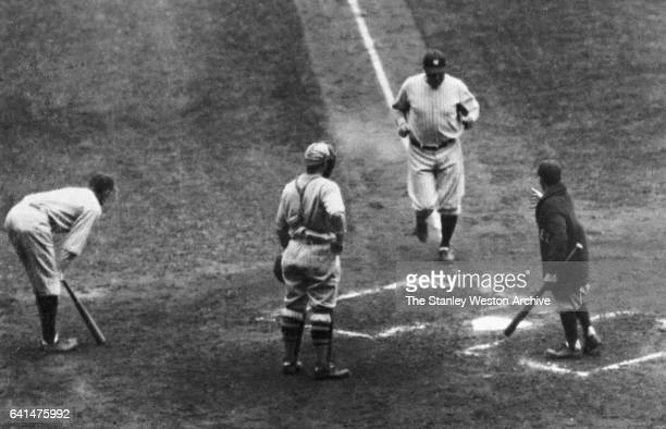 Babe Ruth coming to home plate after hitting a home run in game seven of the 1926 World Series at Yankee Stadium Bronx New York October 10 1927