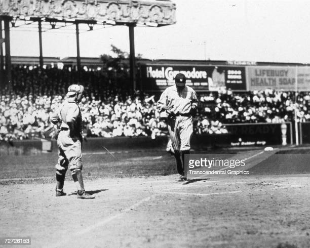 Babe Ruth crosses home plate after hitting a home run during a game in the Polo Grounds in 1921