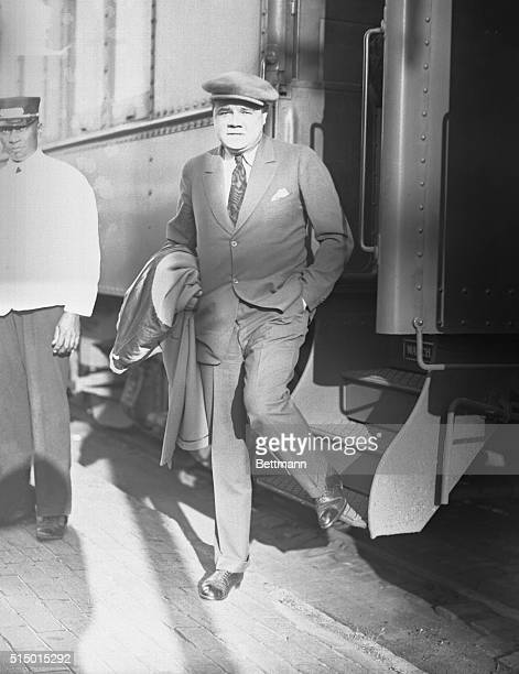 Babe Ruth disembarks from a train in St Petersburg Florida where he is arriving for spring training with the New York Yankees