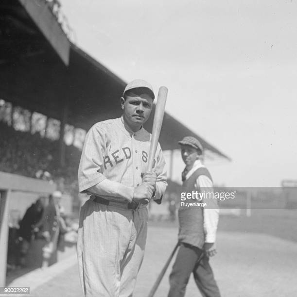 Babe Ruth in Red Sox Uniform with Bat at Stadium
