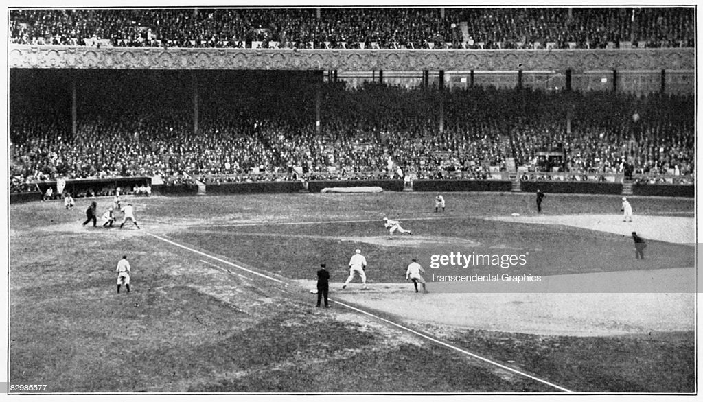 NEW YORK - October 4, 1922. Babe Ruth is at bat in the fourth inning, with Joe Dugan leading off first for the Yankees, with New York GIants pitcher Art Nehf on the mound at the Polo Grounds.