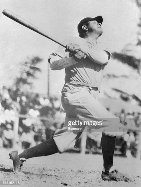 Babe Ruth is shown as he hits one into the bleachers at the stadium at St Petersburg Florida