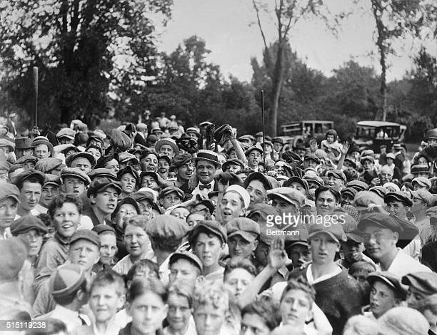 Babe Ruth is shown in the midst of a portion of the 5000 boys who had gathered to see the mighty one of the baseball diamond