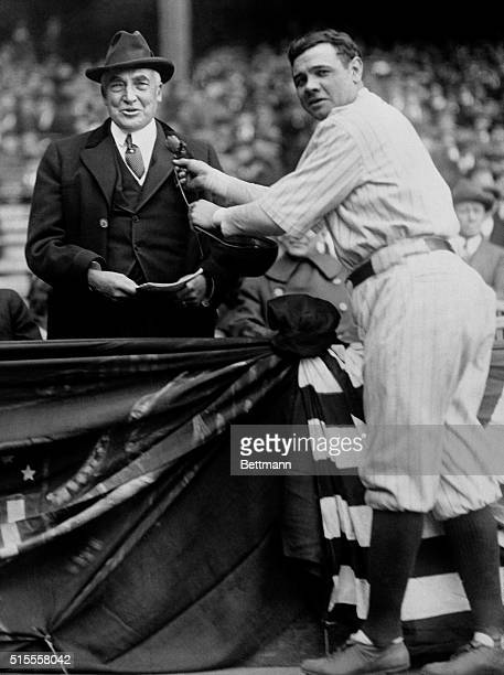 """""""Babe"""" Ruth is shown pinning the National Memorial Flower on the lapel of President Harding after the King of Swat had struck a home run for the..."""