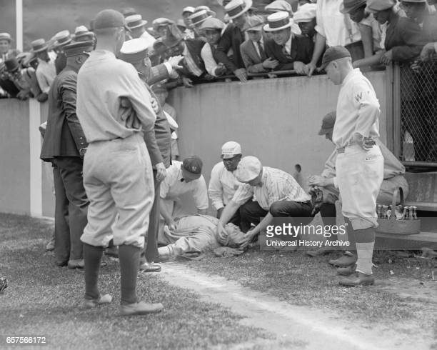 Babe Ruth Major League Baseball Player New York Yankees Knocked out in front of Segregated Section of Fans during Ball Game Washington DC USA...