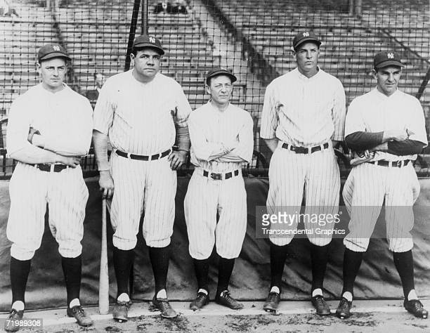 Babe Ruth, New York Yankees outfielder poses with fellow Yankees during the 1927 season. Are Waite Hoyt, Babe Ruth, manager Miller Huggins, Bob...
