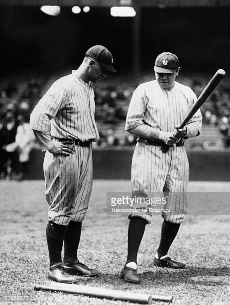 Babe Ruth, New York Yankees outfielder, right, talks about the finer points of hitting with teammate and first baseman Lou Gehrig in June of 1923.
