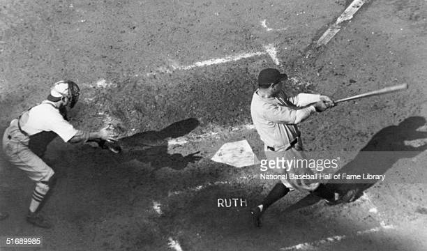 Babe Ruth of the New York Yankees follows through on a swing during a game in the 1926 World Series against the St Louis Cardinals The St Louis...