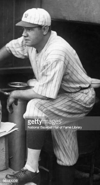 Babe Ruth of the New York Yankees looks on from the dugout during a game Babe Ruth played for the New York Yankees from 19201934