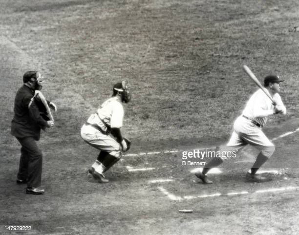 Babe Ruth of the New York Yankees swings at a picth as catcher Gabby Hartnett of the Chicago Cubs follows the ball during the 1932 World Series at...