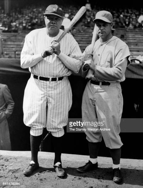 Babe Ruth right fielder of the New York Yankees and Jimmie Foxx first baseman for the Philadelphia Athletics pose for a portrait prior to a game...