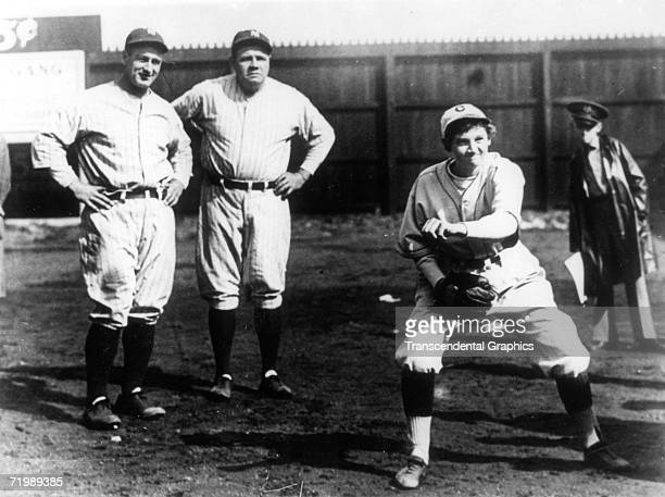 CHATTANOOGA TENNESSEE APRIL 4 1931 Babe Ruth second from left and Lou Gehrig far left watch girl pitching phenom Jackie Mitchell demonstrate her fast...