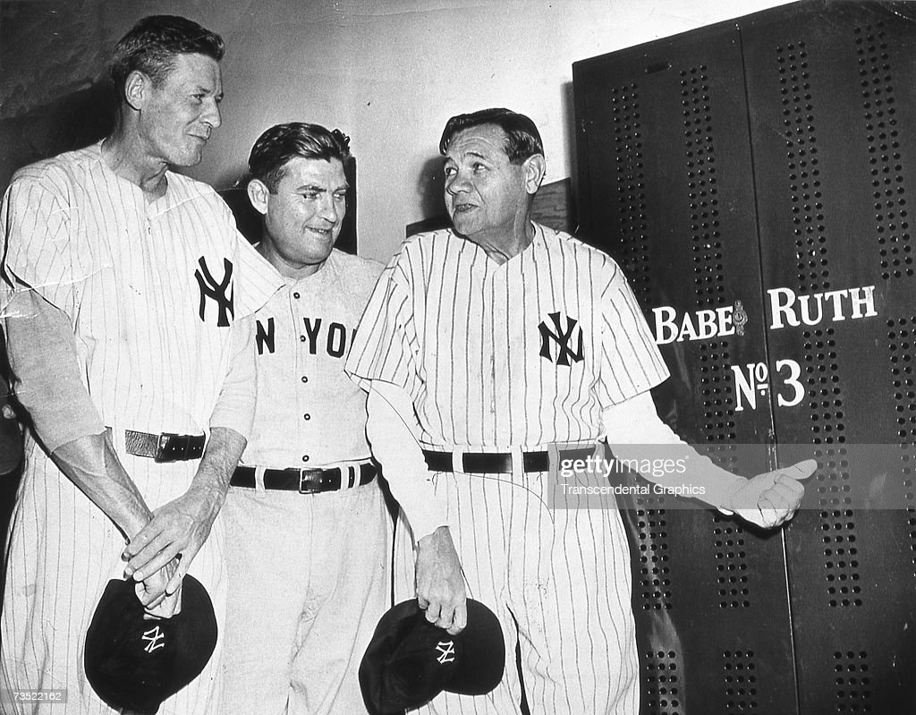 NEW YORK - JUNE 13, 1948. Babe Ruth visits his old locker in Yankee Stadium for the last time on June 13, 1948. On this day Ruth's uniform number was permanently retired. WIth the Babe are Bob Meusel, left, and Mark Koenig, center.