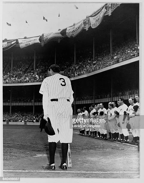Babe Ruth, wearing his Yankees uniform for the last time, acknowledges the crowd at Yankee Stadium in the Bronx at a June 1948 ceremony in which his...