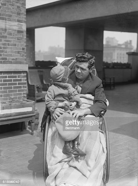 Babe Ruth with his daughter, Dorothy, at St. Vincent's Hospital where the Babe has been a patient for several weeks.