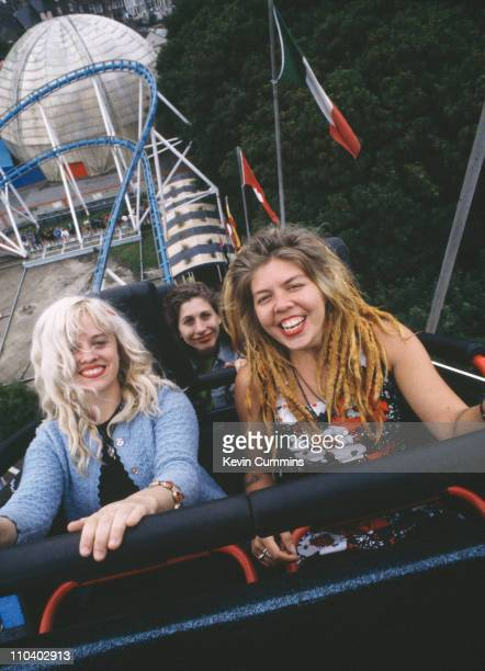 Babes In Toyland on a roller coaster at the Dreamland amusement park Margate Kent July 1992 Left to right singer/guitarist Kat Bjelland bassist...