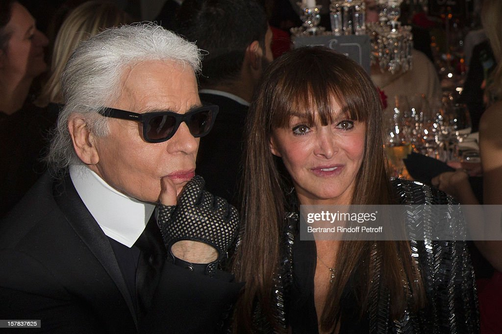 Babeth Djian 'R) and Karl Lagerfeld attend the annual charity dinner for the children of Rwanda, hosted by Babeth Djian to the benefit of A.E.M. (Association Children of The World), at Espace Cardin on December 6, 2012 in Paris, France.