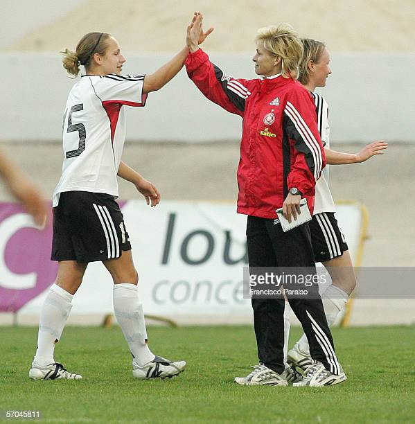 Babett Peter and Coach Silvia Neid of Germany celebrate after winning against Finland during the Womens Algarve Cup match between Germany and Finland...