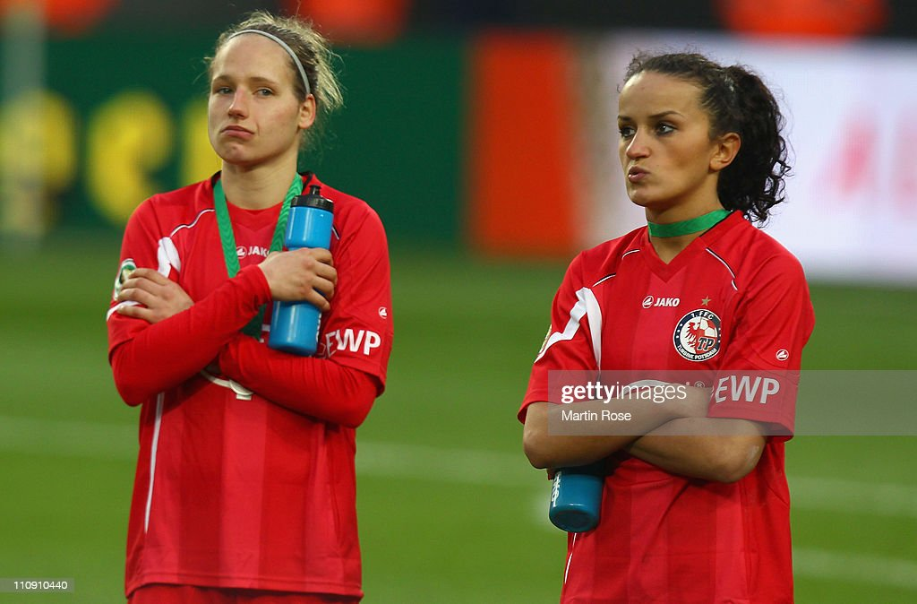 Babett Peter (L) and Fatmire Bajramaj (R) of Potsdam look dejected after the DFB Women's Cup final match between 1. FFC Frankfurt and Turbine Potsdam at RheinEnergie stadium on March 26, 2011 in Cologne, Germany.