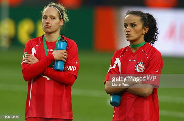 Babett Peter and Fatmire Bajramaj of Potsdam look dejected after the DFB Women's Cup final match between 1 FFC Frankfurt and Turbine Potsdam at...