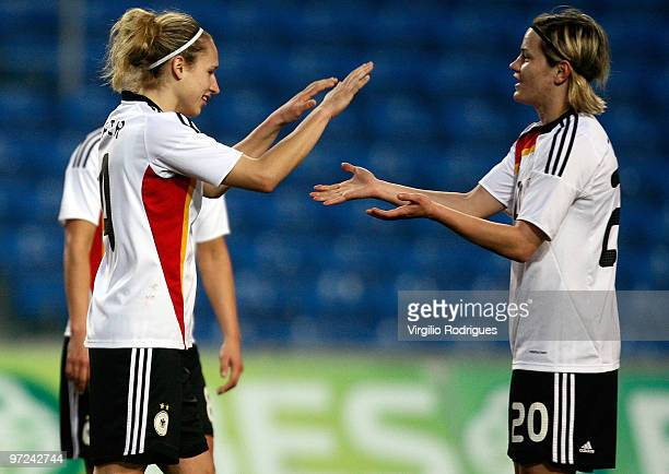Babett Peter and Jennifer Jietz celebrate the goal of Germany during the Woman Algarve Cup match between Germany and China at the Estadio Algarve on...