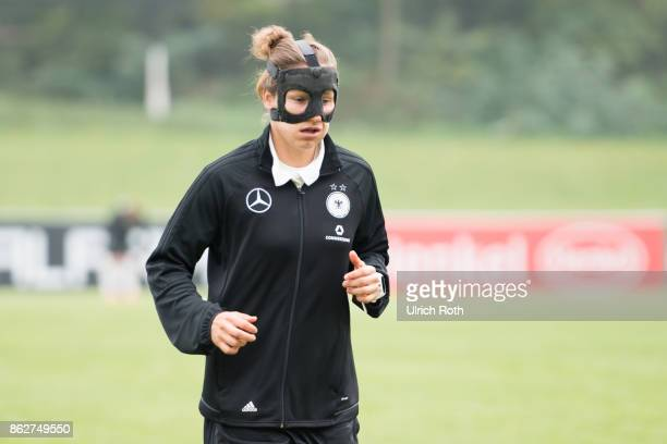 Babett Peter from VfL Wolfsburg warms up while the public training on October 18 2017 in Mainz Germany
