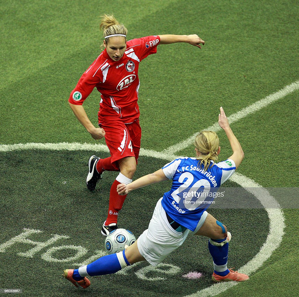 Babett Peter (L) of 1. FFC Turbine Potsdam battles for the ball with Noemie Beney of 1. FC Saarbruecken during the semi-final match of the T-Home DFB Indoor Cup at the Boerdelandhalle on January 23, 2010 in Magdeburg, Germany.