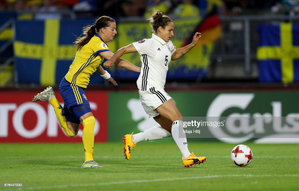 Babett Peter (R) of Germany and Lotta Schelin of Sweden compete for the ball during the Group B match between Germany and Sweden during the UEFA Women's Euro 2017 at Rat Verlegh Stadion on July 17, 2017 in Breda, Netherlands.