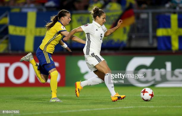 Babett Peter of Germany and Lotta Schelin of Sweden compete for the ball during the Group B match between Germany and Sweden during the UEFA Women's...