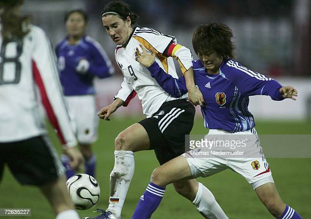 Babett Peter of Germany fights for the ball with Aya Shimokozuru of Japan during the Women's international friendly match between Germany and Japan...