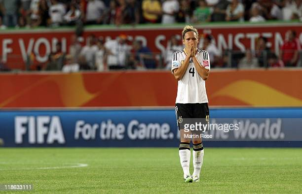 Babett Peter of Germany looks dejected after the FIFA Women's World Cup 2011 Quarter Final match match between Germany and Japan at Wolfsburg Arena...