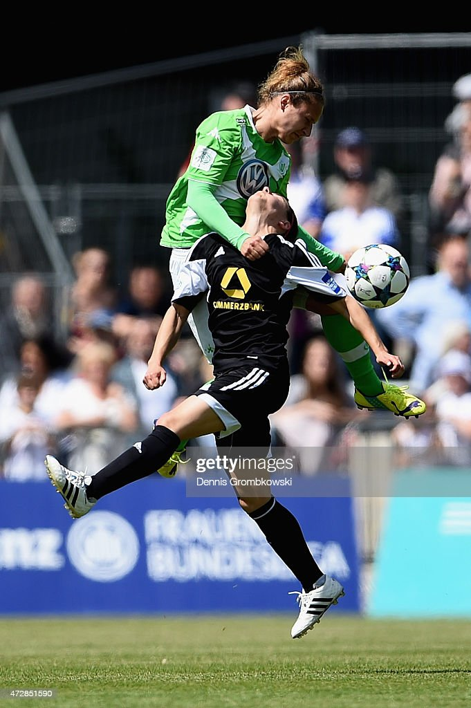 Babett Peter of VfL Wolfsburg and Celia Sasic of 1. FFC Frankfurt go up for a header during the Allianz Frauen-Bundesliga match between 1. FFC Frankfurt and VfL Wolfsburg at Stadion am Brentanobad on May 10, 2015 in Frankfurt am Main, Germany.