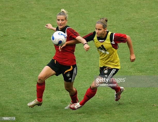 Babett Peter tackles Kerstin Stegemann during the Women's German National Team training session at the Wuhan Sports Center Stadium on September 20...
