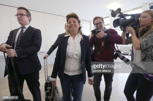 Babette Albrecht arrives with her lawyer at the district court in Essen Germany 19 January 2015 The widow of the ALDI heir Berthold Albrecht who died...
