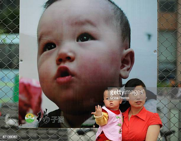 """Babies and parents attend a ceremony at the Beijing Elementary School for the 108 """"Earthquake Babies"""" born in Shifang Arbat Temple on May 13, 2009 in..."""