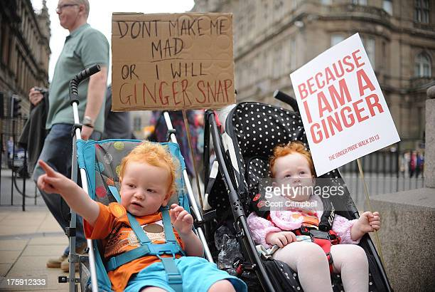 Babies hold up signs at the Ginger Pride Walk on August 10, 2013 in Edinburgh, Scotland. While Glasgow held its annual Gay Pride parade on Saturday,...